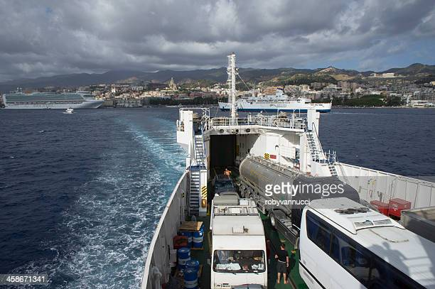 Ferry completely full of vehicles is leaving Messina