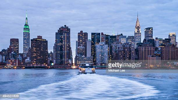 CONTENT] Ferry crosses the East River from Long Island City to Manhattan during the early evening