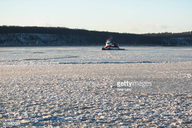 A ferry crosses the frozen Hudson River on January 5 2018 in Dobbs Ferry New York Extreme low tempratures and wind are expected throghout the weekend...