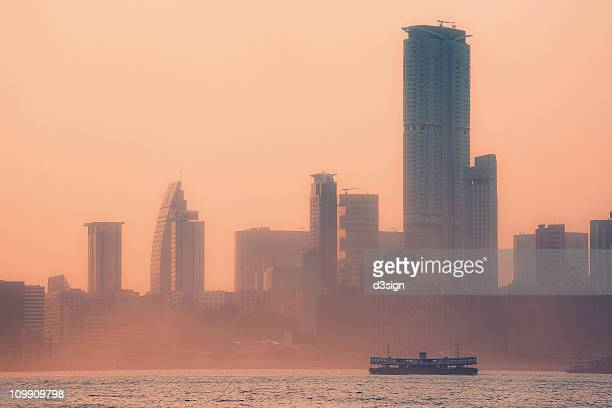 ferry crossing harbour in fog at sunset - star ferry stock photos and pictures