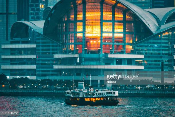 ferry crossing victoria harbour and convention center, hong kong, china - star ferry stock photos and pictures