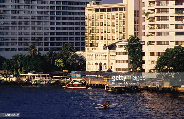 Ferry docks & hotels on the banks of the Chao Phraya (River).