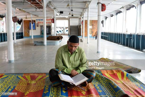 Ferry employee seen reading the Quran during Ramadan amid lockdown. Like every other public transport, ferry services are also suspended amid...