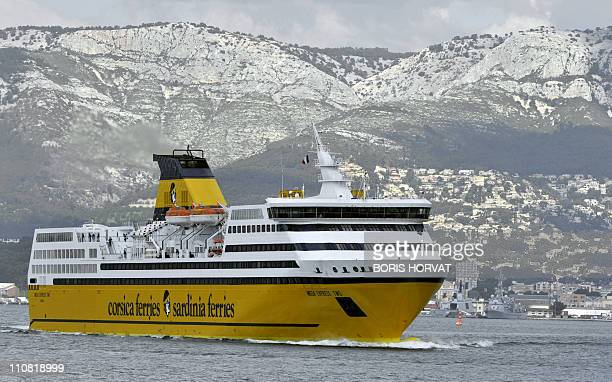 A ferry from Italian Corsica ferries group leaves Toulon harbour southern France on March 20 on its way to Corsica the French Mediterranean island...