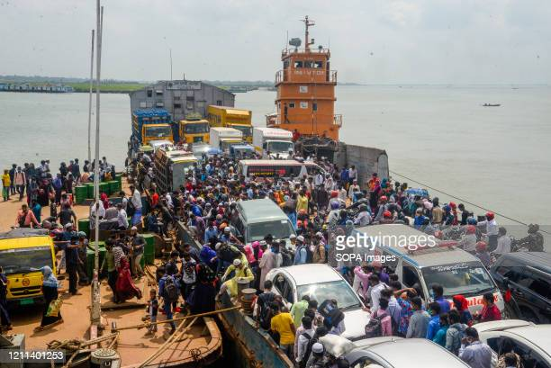 Ferry full of migrant garment workers arrives at Mawa ferry ghat as they are heading towards Dhaka after the government eased the restrictions over...