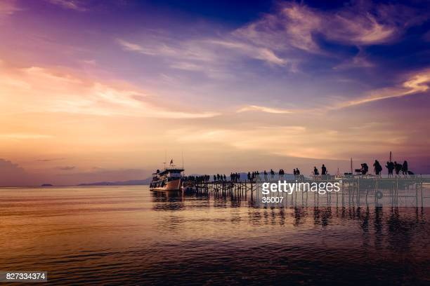 ferry harbor sunset, koh samui, thailand - ko samui stock photos and pictures