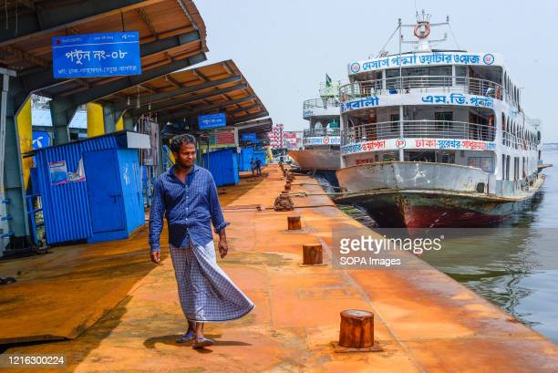 Ferry is anchored at the Buriganga river port as the boat terminal reopens after the Coronavirus lockdown crisis. Bangladesh government is likely to...