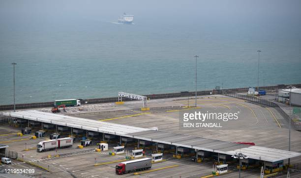 A DFDS ferry makes its way into the Port of Dover as freight lorries pass through border force and customs checkpoints before departing by ferry from...