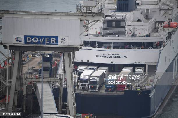 Ferry moors at the port of Dover in southeast England on August 14, 2020. - British holidaymakers faced a scramble to get home today after the...