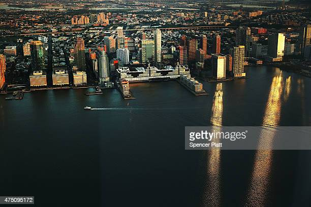 A ferry moves along the Hudson River with the New Jersey coast in view from the newly built One World Observatory at One World Trade Center on the...