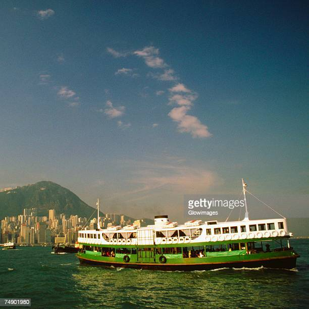 ferry near a harbor, victoria harbor, hong kong, china - star ferry stock pictures, royalty-free photos & images