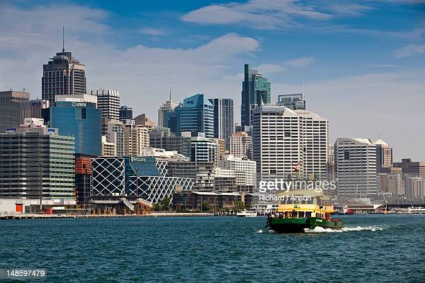 Ferry on Darling Harbour and city skyline.