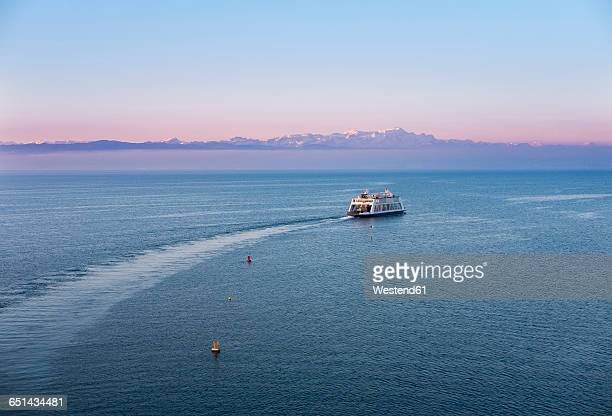 Ferry on Lake Constance in the morning, Mountains Altmann and Saentis in Switzerland in the background