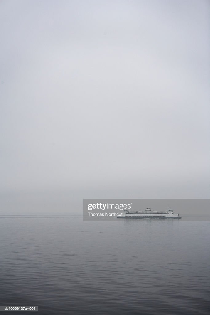 Ferry on sea, distant view : Stockfoto