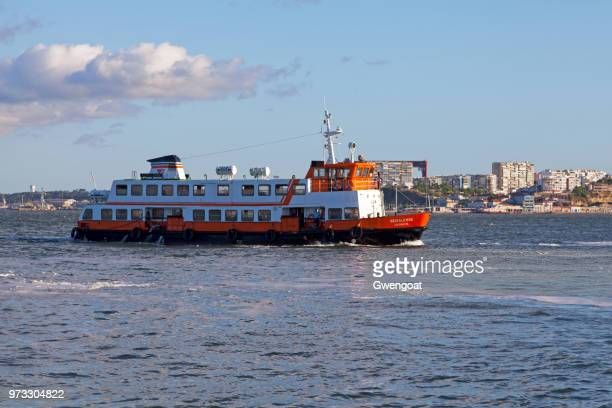 ferry on the tagus river - gwengoat stock pictures, royalty-free photos & images