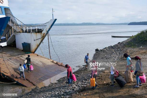 A ferry operated by a Moroccan construction company caries passengers and construction equipment to Corisco on August 11 2018 in Cogo Equatorial...
