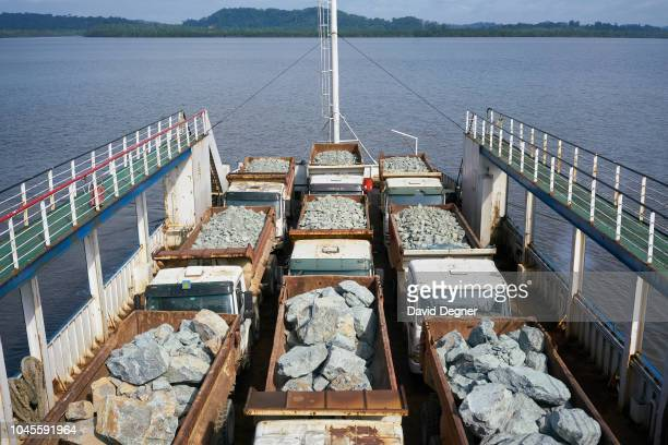 A ferry operated by a Moroccan construction company caries stone and gravel for construction of a harbor to Corisco on August 11 2018 in Cogo...