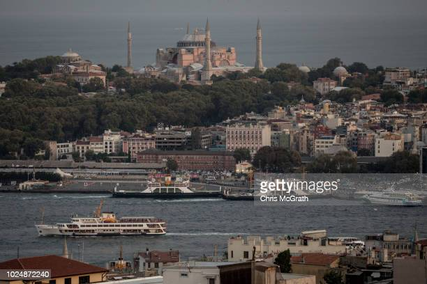 A ferry passes in front of the Hagia Sofia on August 28 2018 in Istanbul Turkey The Turkish Lira continued to weaken Tuesday as tension between the...