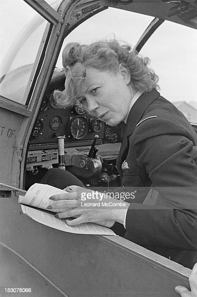 A ferry pilot of the ATA in the cockpit of a Percival Proctor training aircraft at the Elementary Flying Training School at Thame Oxfordshire...