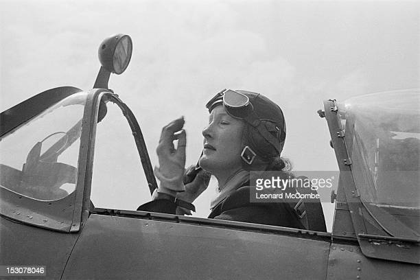 A ferry pilot of the ATA in the cockpit of a Supermarine Spitfire fighter September 1944 ATA pilots deliver newly manufactured aircraft from the...