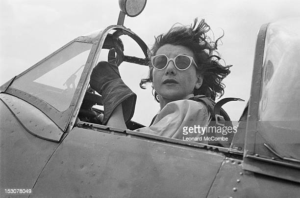 Ferry pilot of the ATA in the cockpit of a Supermarine Spitfire fighter, September 1944. ATA pilots deliver newly manufactured aircraft from the...