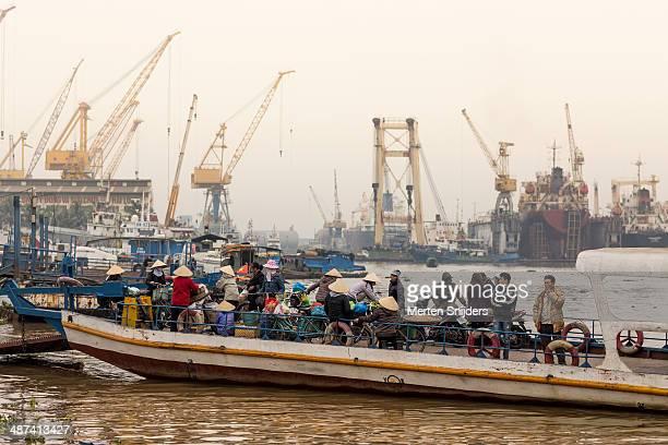 ferry platform with people in industrial harbour - merten snijders stock-fotos und bilder