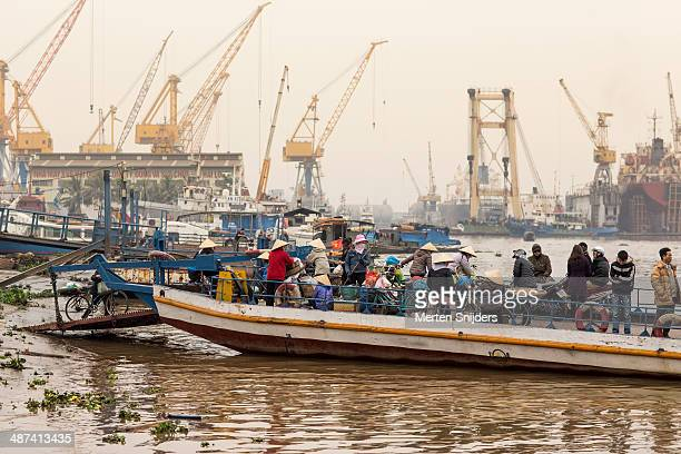 ferry platform with people in industrial harbour - merten snijders stock pictures, royalty-free photos & images