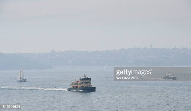 A ferry plies it's trade on Sydney Harbour with the city shrouded in smoke on October 21 2016 The smoke drifted over the city from burnoffs on the...