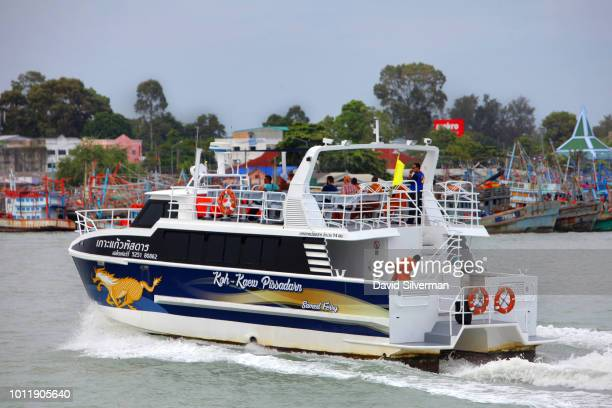 A ferry returns from Ko Samet Island on July 25 2018 to the port of Rayong in the Gulf of Thailand Ko Samet popular with foreign tourists and as a...