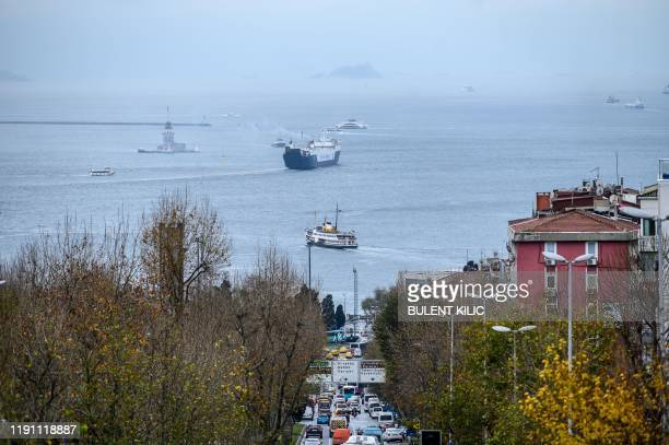 A ferry sails across the continents as the entrance of the Bosphorus on December 26 in Istanbul President Recep Tayyip Erdogan's dream project of...