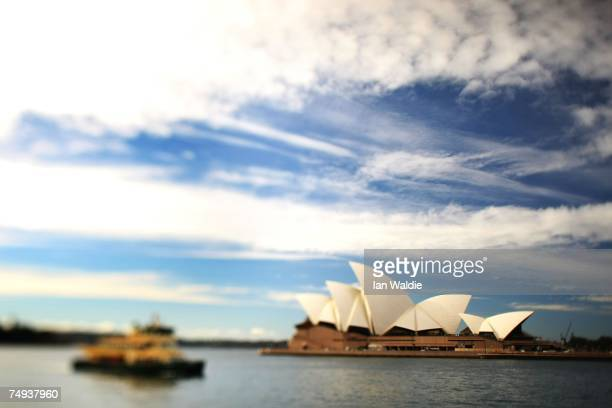 A ferry sails past the Sydney Opera House June 28 2007 in Sydney Australia The Opera House designed by Joern Utzon and officially opened in October...