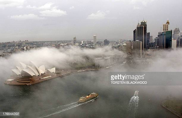 Ferry services resume as the heavy winter fog begins to lift from Sydney Harbour on June 3 2008 After Sydney experienced record rainfall in April May...