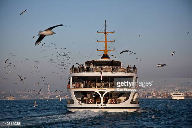 A ferry sets off from the Galata Bridge along the Bosphorus of Istanbul on February 23 2012 in Istanbul Turkey Though not the capital Istanbul is the...