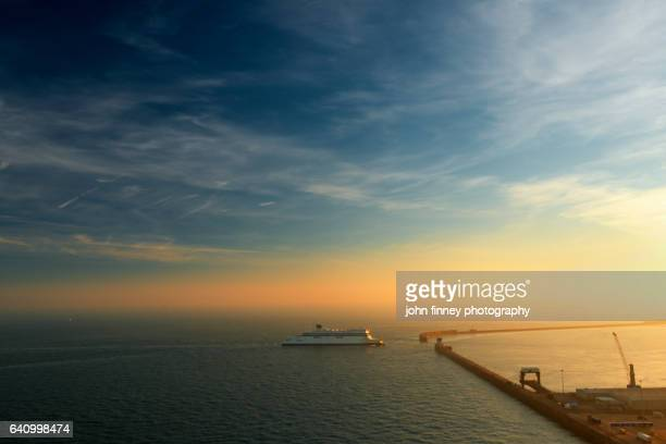 ferry ship entering dover port at sunset. kent. uk. - english channel stock photos and pictures