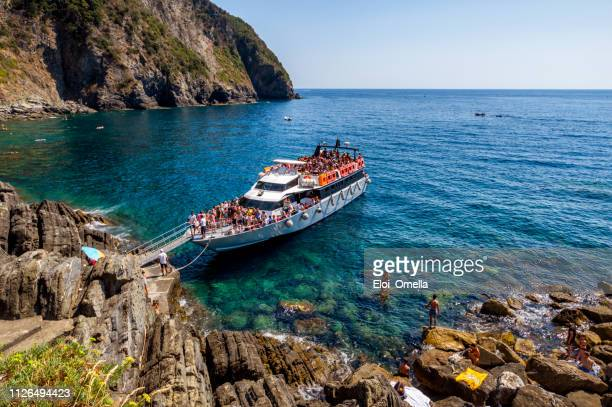 ferry tourist in riomaggiore, cinque terre national park. italy - cinque terre stock pictures, royalty-free photos & images