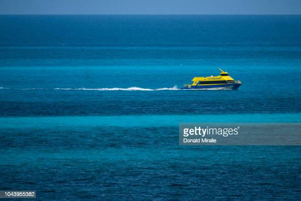A ferry transports tourists between Isla Mujeres and mainland in Cancun Mexico on September 27 2018 Cancun and the surrounding areas a re a major...