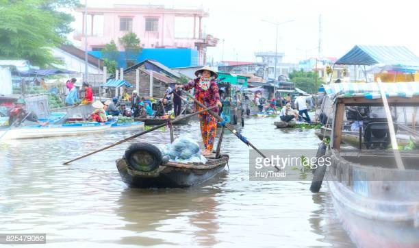 ferry women take visitors sailing across the river - can tho province stock pictures, royalty-free photos & images