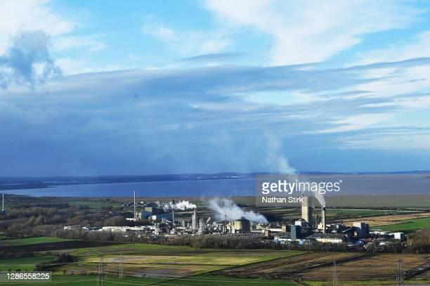 Fertilisers UK Ltd factory is seen next to Frodsham Wind Farm from Helsby Hill on November 19, 2020 in Helsby, England. The UK Government released...