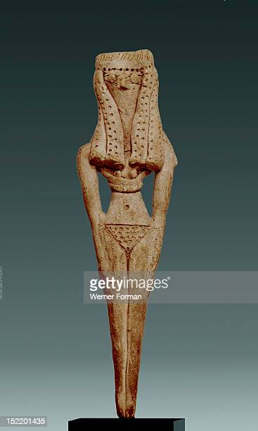A fertility figure of a woman Fibres with small mud pearls stuck on were once threaded through the little holes in the hair The elaborate headdress...