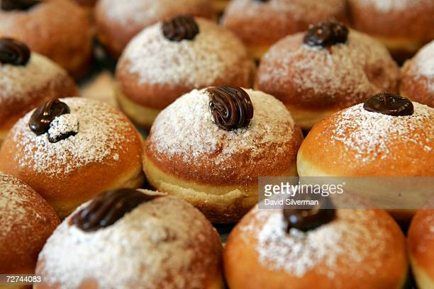 Fesh oil-fried and caramel-filled doughnuts, called sufganiyot in Hebrew, on display at the Roladin bakery December 5, 2006 in Kadima in central...