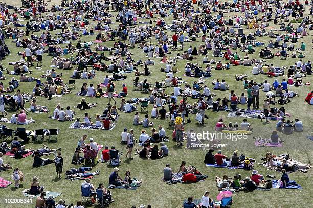 Fesitval goers soak up the sunshine by the main stage during day two of the Isle of Wight Festival 2010 at Seaclose Park on June 12 2010 in Newport...