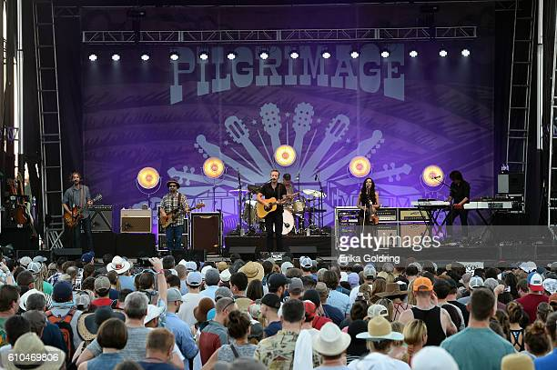 Fesivial goers watch Jason Isbell perform onstage at the Pilgrimage Music Cultural Festival Day 2 on September 25 2016 in Franklin Tennessee