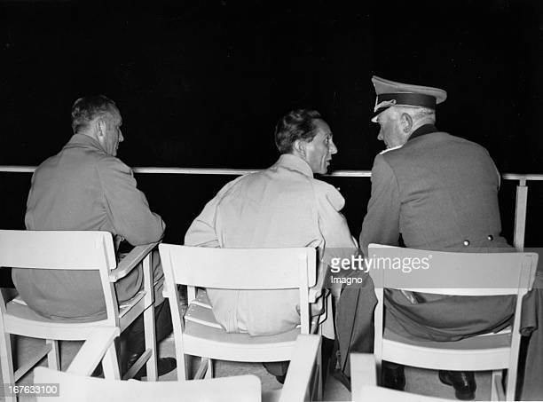 Festival at the Olympic Stadium for the 700th anniversary of the capital Berlin From left to right War Minister Field Marshal Werner von Blomberg the...