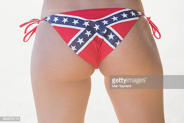 A festival attendee displays a Confederate flag bikini bottom during the Watershed Music Festival at Gorge Amphitheatre on July 31 2016 in George...
