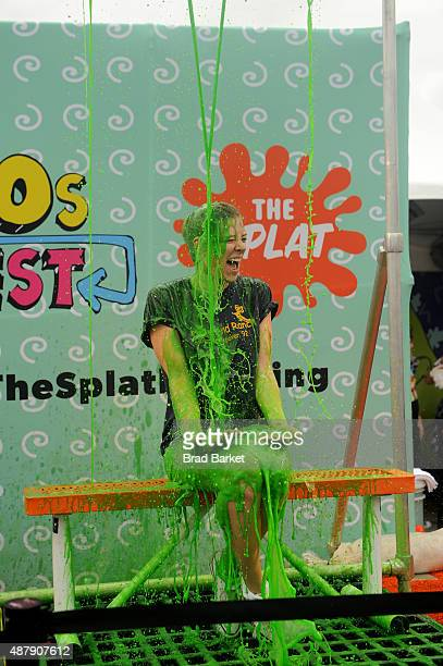 A festival attendee gets slimed at 90sFEST Pop Culture and Music Festival on September 12 2015 in Brooklyn New York