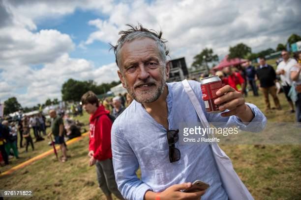 A festival attendee wears a Jeremy Corbyn mask as he holds a beer at the main stage at Labour Live White Hart Lane Tottenham on June 16 2018 in...