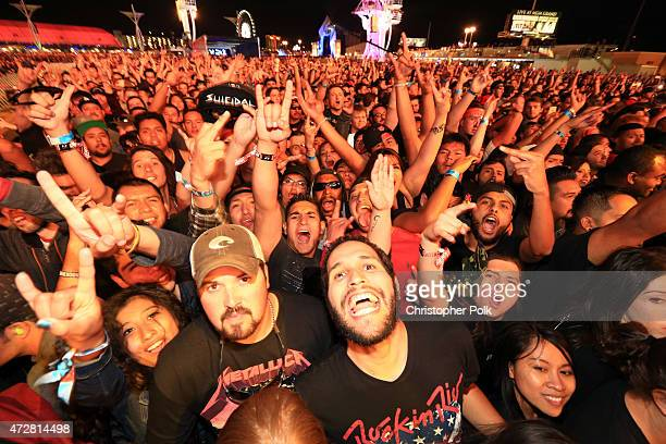 Festival attendees listen to live bands perform onstage during Rock in Rio USA at the MGM Resorts Festival Grounds on May 9 2015 in Las Vegas Nevada