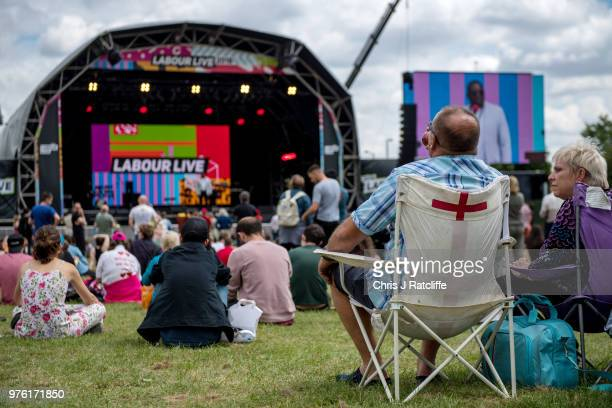 Festival attendees watch David Lammy MP speak on the main stage at Labour Live White Hart Lane Tottenham on June 16 2018 in London England The first...