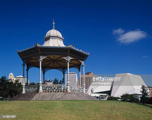 festival centre & rotunda in elder park, skyline in b/g, adelaide, sa - adelaide festival stock pictures, royalty-free photos & images
