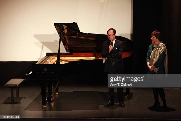 Festival coordinator Francoise Clerc looks on as Institut Francais Director Laurent Burin des Roziers speaks before Pianist Nick van Bloss performs...